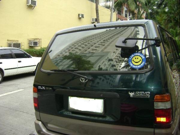 Smiley Anti-RH Sticker on a Van