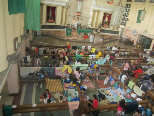 Flood victims take refuge in a church in Pasig